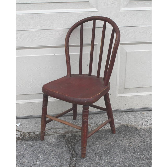 This hoop back child's chair has a wonderful original red crackle surface. This small windsor or plank bottom is in as...