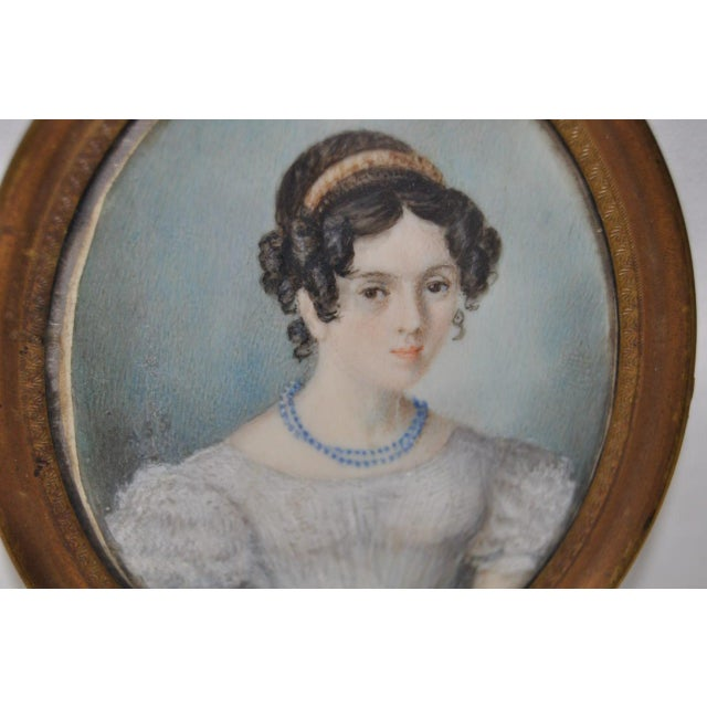 A splendid mid 19th century portrait miniature of a beautiful young lady. The miniature has no visible signature, and...