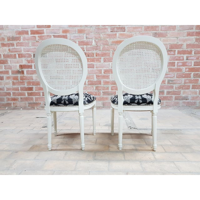 Pair of Vintage French Louis XVI Newly Upholstered Cane Back White Accent Chairs For Sale - Image 4 of 13