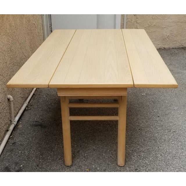 Century Design foldable table can be utilized as a console or dining table. Has original brass hardware and was...