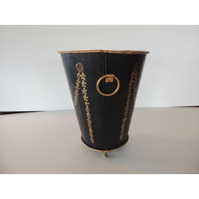"""Tole Black and Gold Catchpot depicting garlands and bows. Small gold leaf feet. Size: 7.5""""D x 9""""H"""