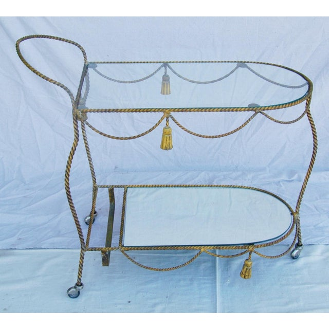 1950s Italian rope and tassel motif tea/bar beverage liquor tea cart. Features a wonderfully detailed metal base in a gold...