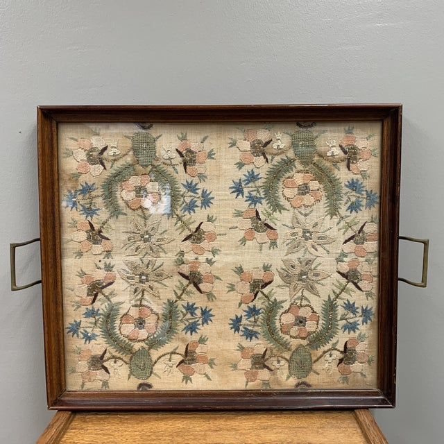 This is a wonderful antique textile that has been framed in glass into a tray. The back is felt lined and wired for...