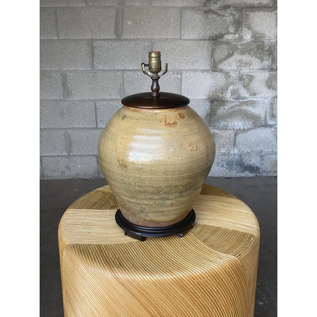 Outstanding vintage boho glazed pottery lamp. Beautiful wood cap and plinth. Beautiful warm gold colors. Acquired from a...