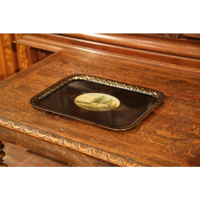 Elegant antique tray from France, circa 1870; rectangular in shape, the black tole platter is embellished by hand-painted...
