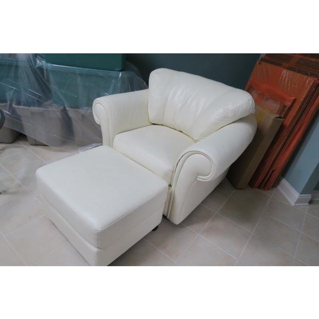 Beautiful white leather chair & ottoman set in almost new condition. Comfy; no marks; chair has new foam filling.