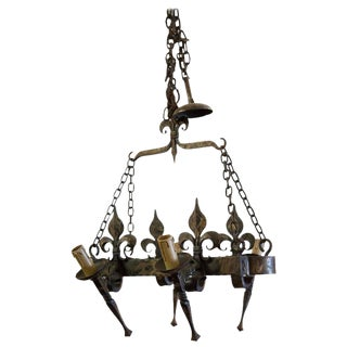 Country French Four Light Hand-Forged Iron Fleur de Lis Chandelier For Sale