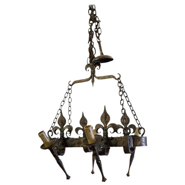 French Country Four Light Hand-Forged Iron Fleur De Lis Chandelier For Sale