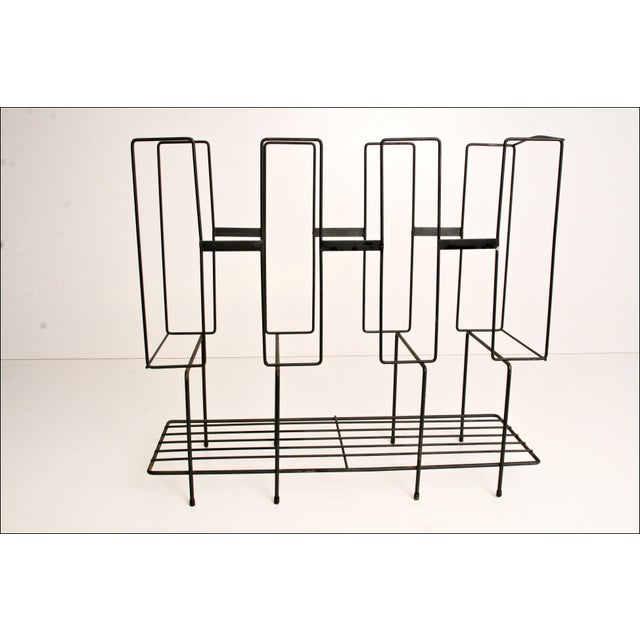 Vintage Metal Wire Rack. Steel construction with black paint. Nice streamlined mid century Modernist look. Measures approx...