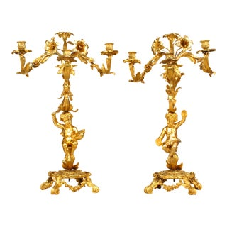 Pair of French Louis XV Style Bronze Dore Cupid Base Candelabra For Sale