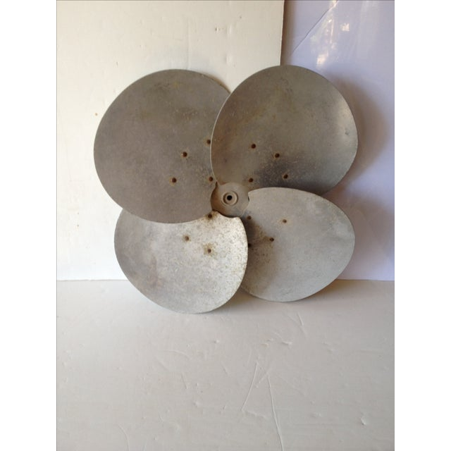 Industrial wall art fan blades are in every decorating magazine. This one is a good manageable size for most walls. This...