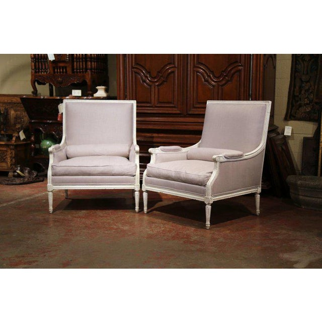 Complete your formal living room with this elegant pair of antique armchairs; created in France, circa 1880, the large...