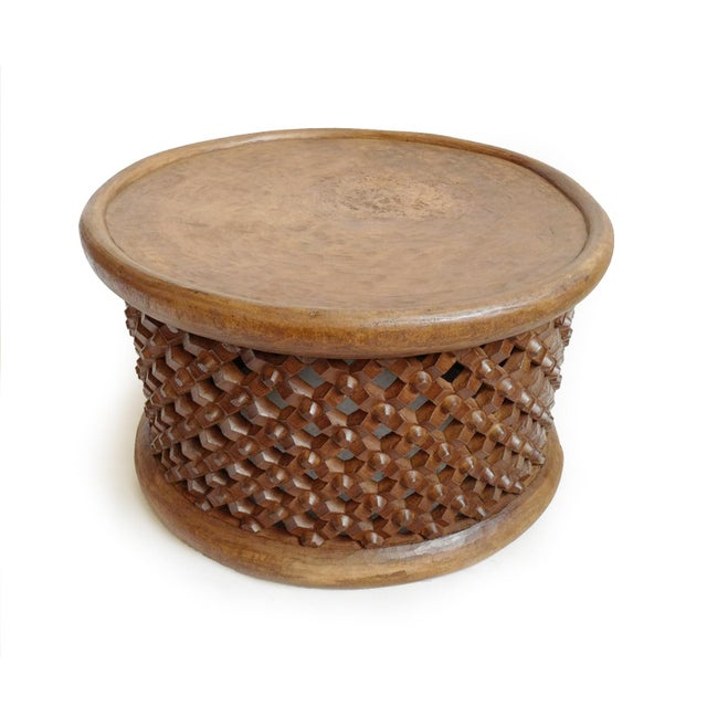 Authentic raw wood finish Bamileke wood carved stool from Cameroon. Beautiful natural wood grain carved from one solid...