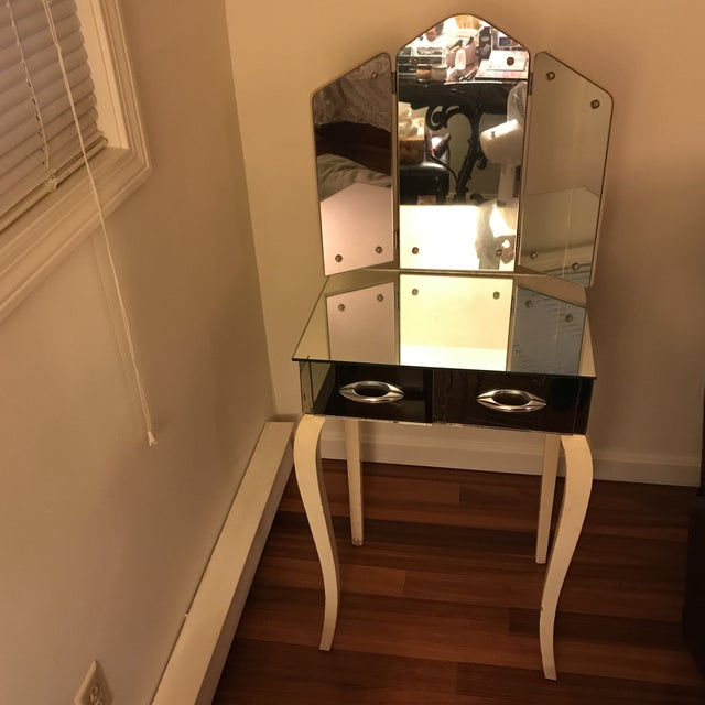 Beautiful Antique 1940's mirrored vanity. Excellent condition and hard to find. No chips or cracks. Tri-view mirror. Two...