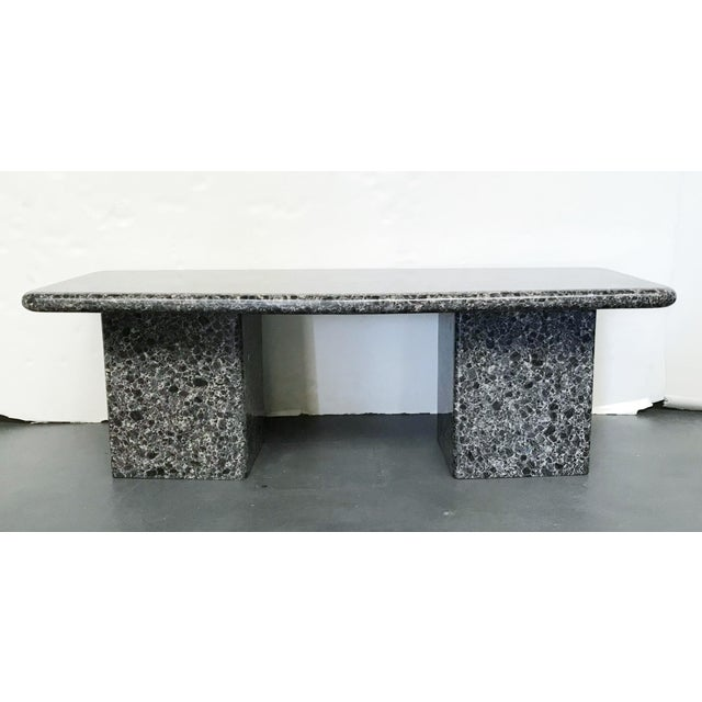 Vintage midcentury granite coffee or cocktail table with beautiful large specs, featuring a rounded rectangular top...