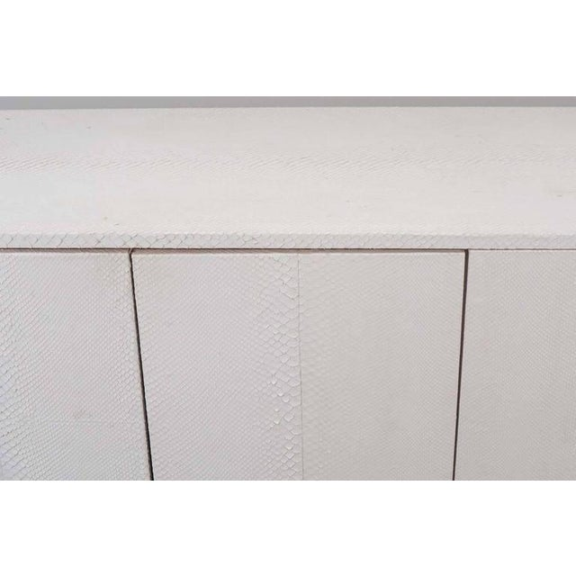 White python sideboard with Lucite side panels.