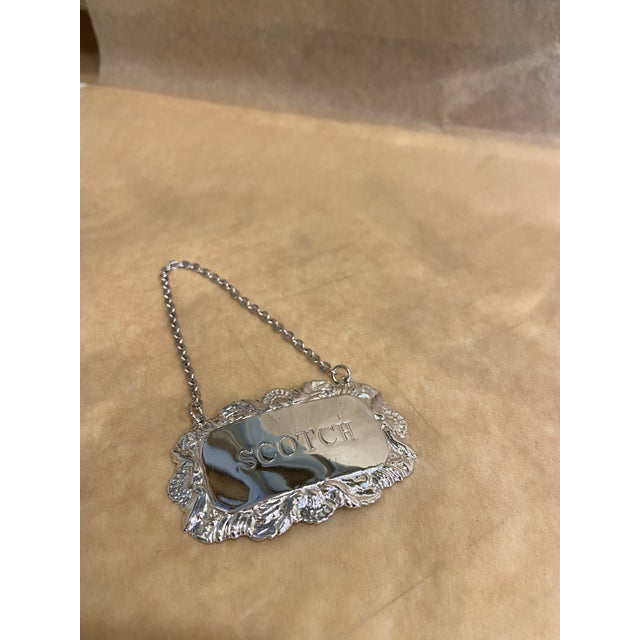 """This is a beautiful vintage decanter tag labeled """"SCOTCH"""". It is a very interesting label for a collection. It is silver..."""