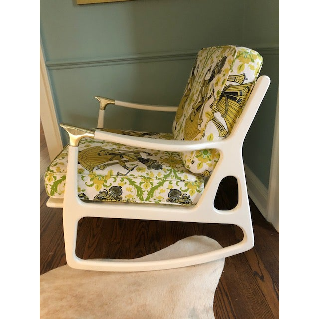 Reminiscent of Danish mid century designs, this modern rocker features a wide- set silhouette with tufted cushions...