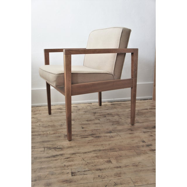 George Nelson for Herman Miller Lounge Chair. c. 1960's. Walnut frame with original upholstery in wool twill fabric in...