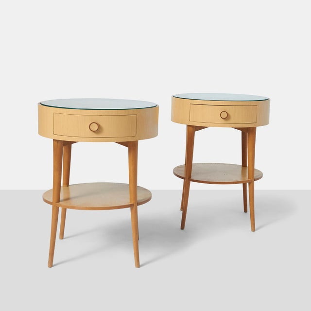 Pair of Joaquim Tenreiro Side Tables A pair of Joaquim Tenriero side tables in ivory wood with glass top. There is a lower...