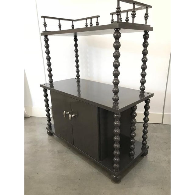 Two tier, gray ,high-gloss bar with classic spindles by Dunes and Duchess . Made with love in Connecticut, classic ball...
