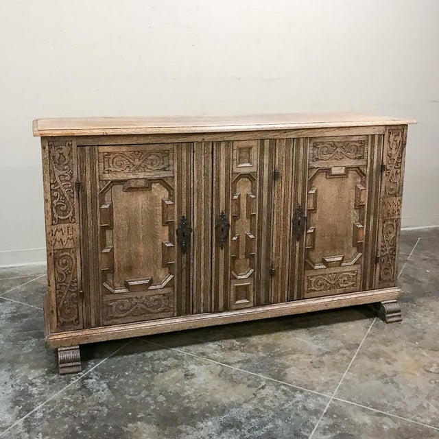 19th Century English Stripped Oak Buffet is a handsome, tailored expression of rustic rural English styling that will...