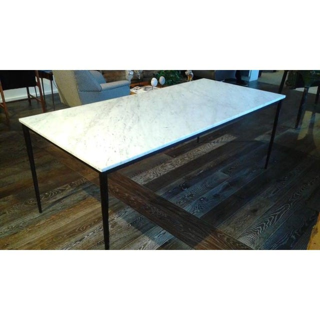 Fabulous 20th Century rectangular large dining table with iron base and marble top. Tapering iron legs finely hold the...