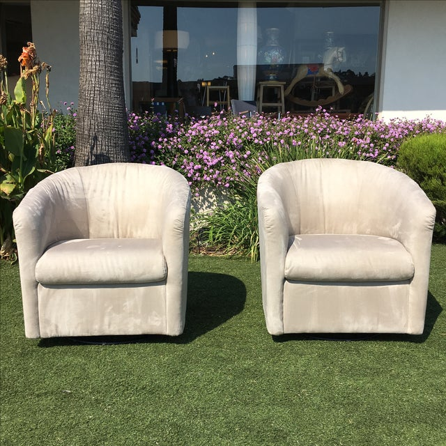 Design Plus Gallery presents a pair of classic barrel chairs by Natuzzi. In easy-care microsuede, this neutral pair...