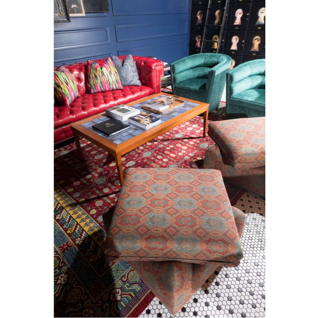Beautiful custom made ottoman, consist of a light blue, red orange, and pale orange. These ottomans are in perfect condition!