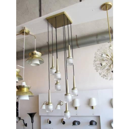 Stunning eight hanging lights by Staff of Germany, encased in heavy molded glass, brushed brass, lengths and configuration...