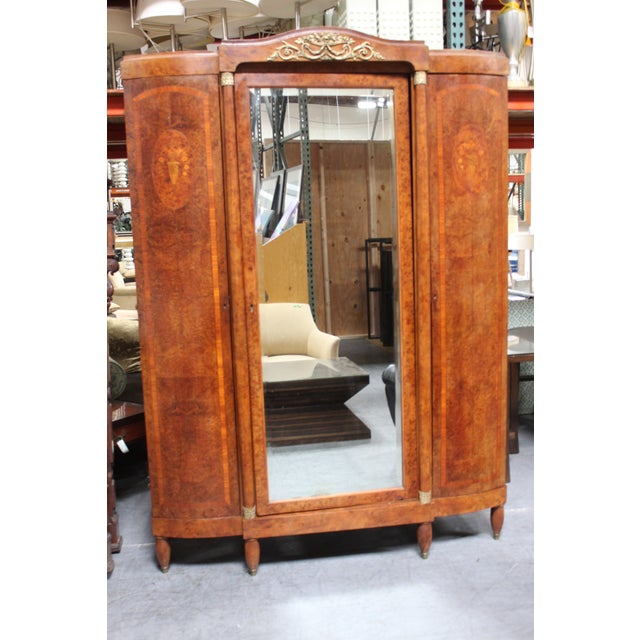 FRENCH STYLE ARMOIRE WITH LOTS OF SPACE AND FINE DETAILED EMBELLISHMENTS. BEAUTIFUL MIRROR. Note: We professionally crate...