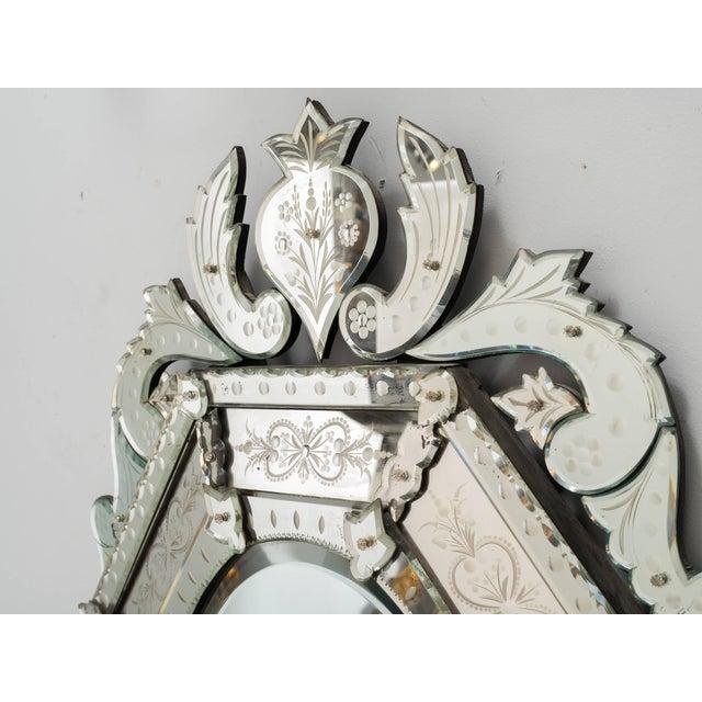 1930s octagonal Venetian mirror with crown.