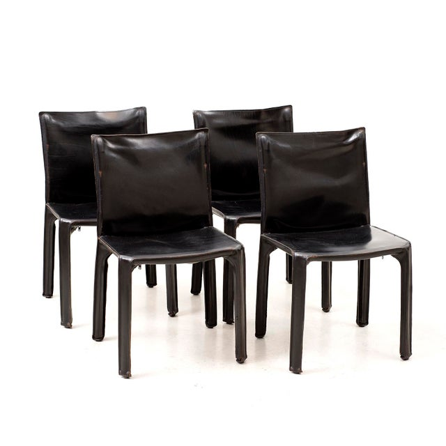 Gorgeous matching set of 10 Cab Chairs in black leather by Mario Bellini for Cassina. Six Armchairs and 4 side chairs....