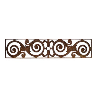 Circa 1900 Traditional Cast Iron Distressed Finish Grill With Scroll Motif For Sale