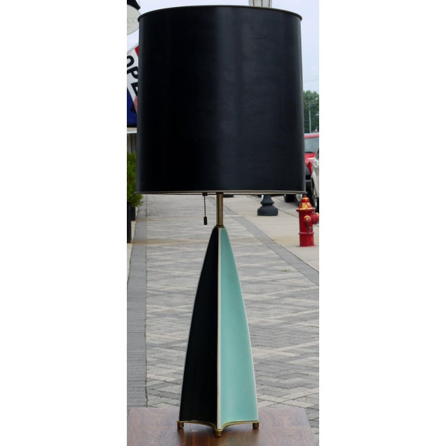 A pair of parabolic fin table lamps by Gerard Thurston. Stoneware body is made up of four fin like shapes that have...