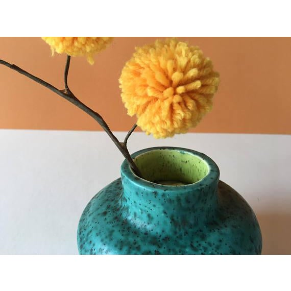 Vintage Handmade Stoneware Vase. Turquoise outside with a chartreuse green inside, both with a black splatter. ➝ Measures...