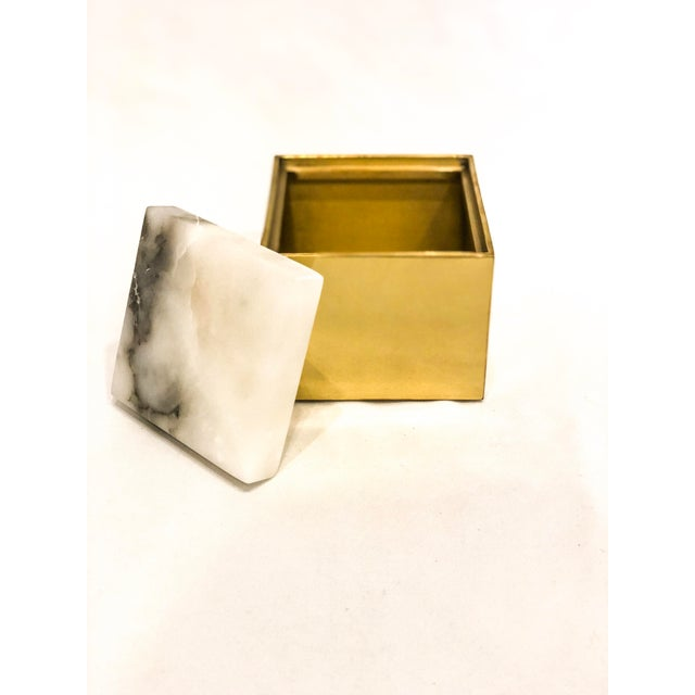 Anna by Rablabs stunning small Scatola box pairs an Italian alabaster lid with a solid brass base. Stone color and pattern...