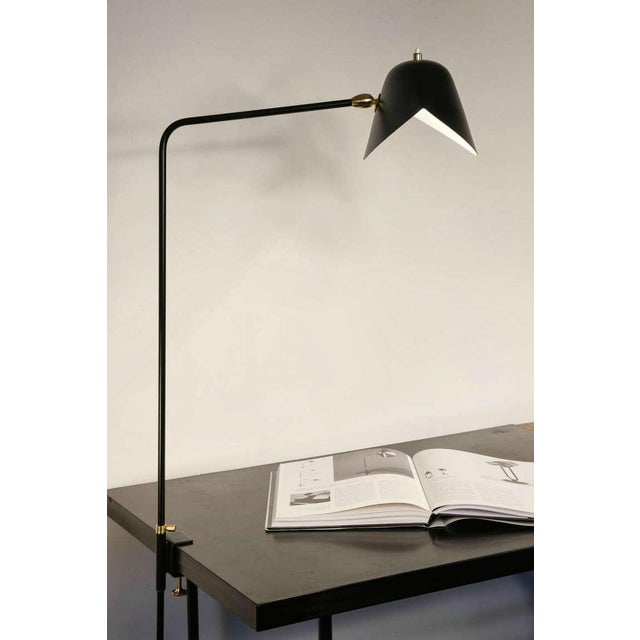 Clamp desk lamp. At 36 inches at its highest, these lamps may affix to many surfaces providing direct lighting where it is...