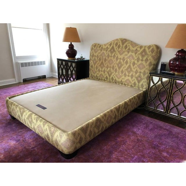 Gorgeous Donghia platform bed with Ikat upholstery called Butwai in beige. 100% cotton jacquard has been recently cleaned....