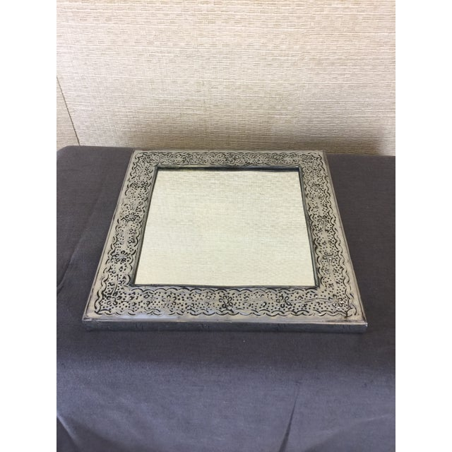 This Mexican handmade Punch Tin square mirror is a classic display of southwest art. There are 2 holes in the back for...