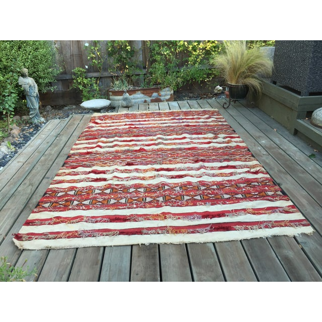 Vintage Bohemian style rug, hand woven by women for their wedding day. The design on this carpet is white and red...