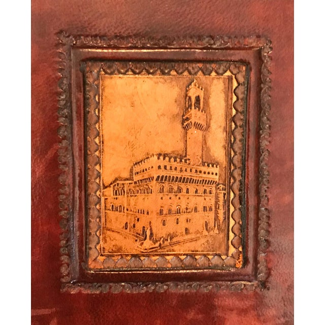 Just right for your library, den or office. A pair of handsome brown and camel leather bookends. Intricate detail at the...