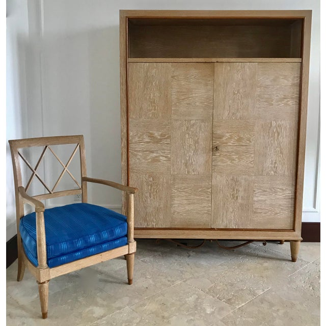Up for sale is a tremendous mid century French limed oak cabinet. This cabinet has two doors and has 3 shelves on the inside.