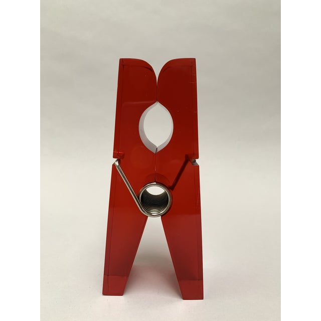 This modern, whimsical, jumbo lucite clothespin is such a great piece of functional pop art. It can be used as a...