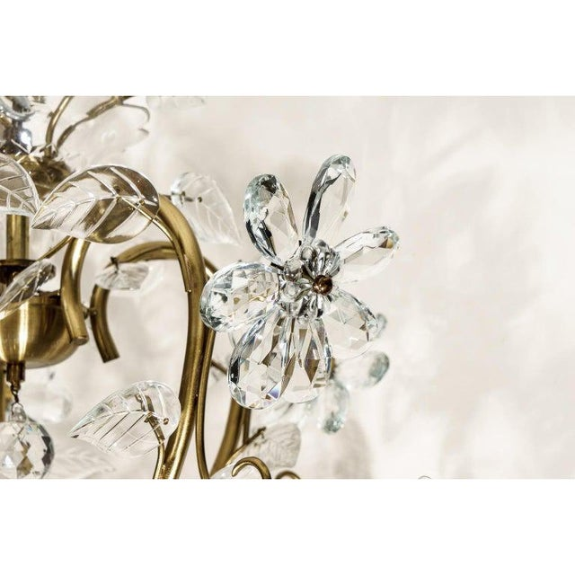 This stylish and romantic Louis XV style chandelier is detailed with stylized crystal flowers and foliage. Note: Height...