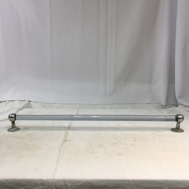 This is a timeless vintage lucite towel bar with a pair of matching chrome towel bar holders. The lucite bar has a slight...