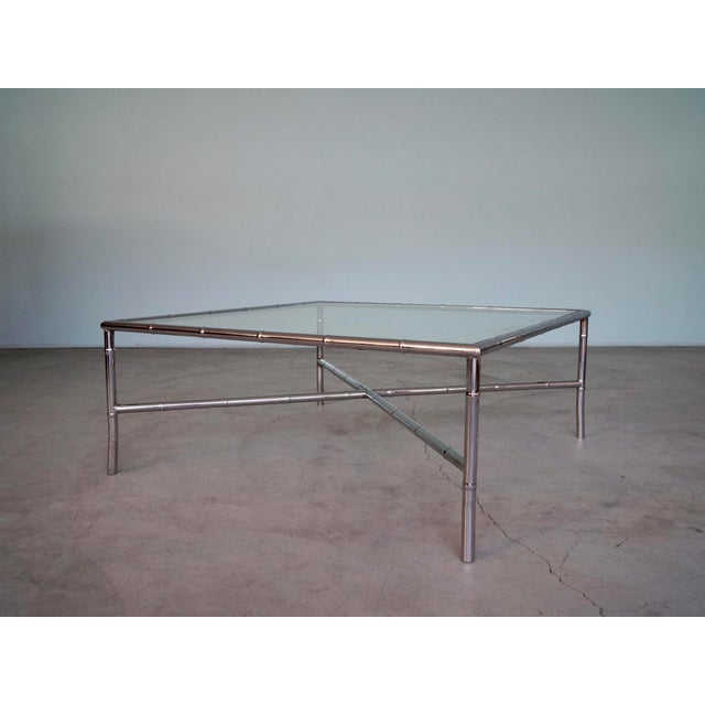 We have this stunning original 1960's mid-century modern coffee table for $1,750. It's a designer piece, and has a faux...