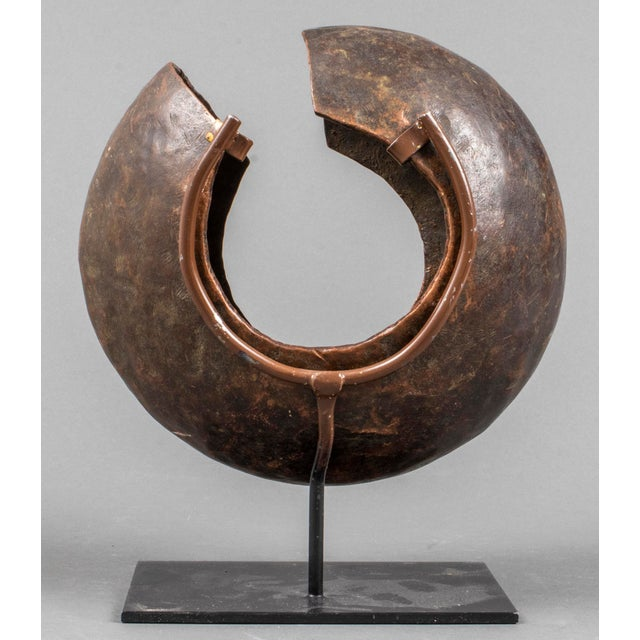 African Mbole People (Democratic Republic of the Congo) copper currency anklet ring, spherical in form with open side,...