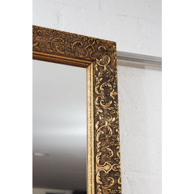 This nice french mirror from the early 1900's has a nicely angled frame with gilded plaster caste flora and fauna...
