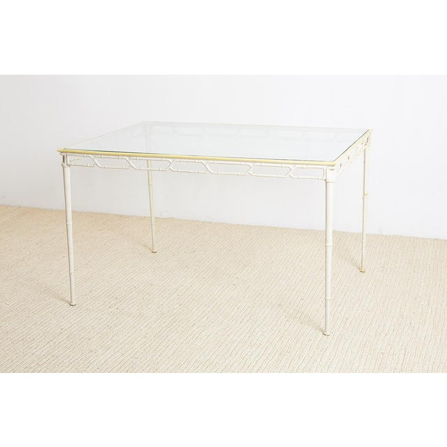 Palm Beach style brown Jordan Calcutta garden or patio table featuring a faux bamboo painted aluminium frame. Chinese...